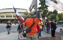 Open carry advocates gather across from the Fort Worth Convention Center during the Republican Convention on June 5, 2014.