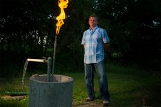Steve Lipsky shows the methane contamination of his well by igniting the gas with a lighter outside his family's home in Parker County near Weatherford, Texas on June 17, 2014.