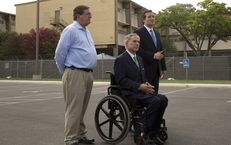U.S. Rep. Michael Burgess (left), R-Flower Mound, joined Attorney General Greg Abbott and U.S. Sen. Ted Cruz for a news conference on June 23, 2014, after touring a Lackland Air Force Base facility in San Antonio that was serving as a shelter for unaccompanied minors who crossed the border.