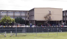 Children and teens play in the courtyard of the facility they are currently being housed  in at Lackland AFB in San Antonio, Texas on June 23rd, 2014. The facility is currently holding hundreds of minors who have crossed Texas-Mexico border unaccompanied.