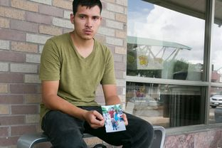 "Julio Cesar Garcia Duarte, holds a photograph of his common law wife and son at a bus station in McAllen. He was told a ""coyote"" would deliver them to the Rio Grande but doesn't know their whereabouts."