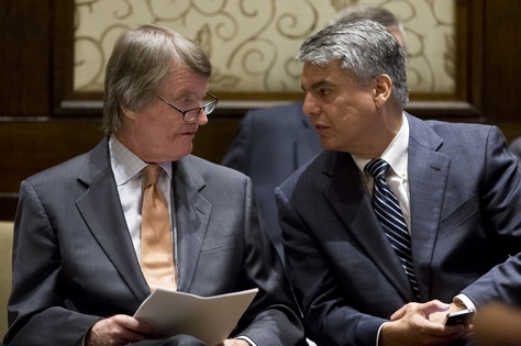 University of Texas President Bill Powers speaks to Provost Gregory Fenves during a board of regents meeting on July 10, 2014.