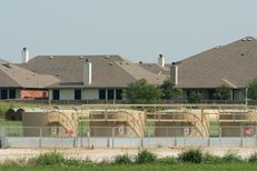 A gas well last fracked in March sits 385 feet from Debbie Ingram's home in Argyle, Texas on July 22, 2014.