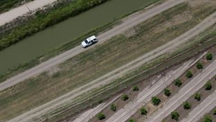 A Customs and Border Protection vehicle patrols on the Texas border near the Rio Grande, Thursday, July 24, 2014, in Mission, Texas. Texas is spending $1.3 million a week for a bigger DPS presence along the border.