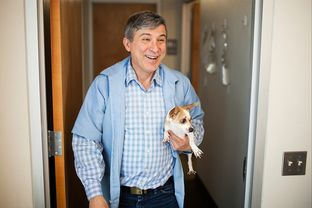 Dr. Orlando Garza walks with a dog that was boarding at his animal hospital on Monday in El Paso. Garza has been a practicing veterinarian since 1982.