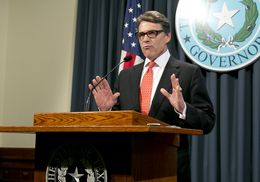 Gov. Rick Perry speaks to reporters on Saturday, Aug. 16, 2014, the day after a grand jury indicted him on two felony counts related to his veto of public integrity unit funding.