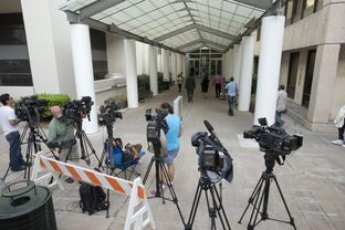 News crews anticipated that Gov. Rick Perry would be processed on Monday, Aug. 18, 2014, at Travis County's Blackwell-Thurman Justice Center. Perry, who was indicted on charges related to his veto of public integrity unit funding, called the indictment without merit and politically motivated.