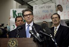 A defiant Texas Governor Rick Perry speaks to supporters after his booking at the Travis County Courthouse on August 19, 2014.