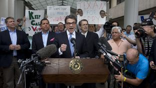Gov. Rick Perry speaks to the media and supporters after being booked at the Travis County Justice Center on August 19, 2014.