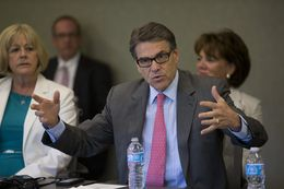 Gov. Rick Perry speaks on his Texas economic efforts while speaking to New Hampshire business leaders in Portsmouth on Aug. 22. 2014.