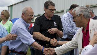 Gov. Rick Perry is shown with New Hampshire voters at the Defend Freedom Pork Roast in Rochester on Aug. 23, 2014.