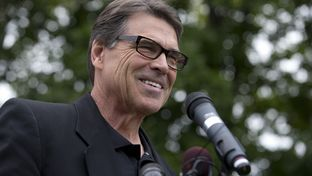 Gov. Rick Perry talks with New Hampshire voters at a GOP rally in Stratham, N.H., on Aug. 25, 2014.