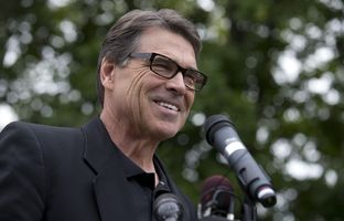 Gov. Rick Perry talks with New Hampshire voters at a morning GOP rally in Stratham, NH on Aug. 25, 2014.
