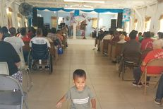 """Junior"" Silva walks through the chapel and the Senda de Vida immigrant shelter in Reynosa, Tamaulipas on August 24, 2014."