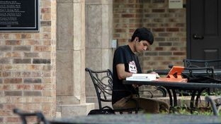 A student works on the campus of what is currently the University of Texas at Brownsville. Next year, it will officially become a part of the University of Texas-Rio Grande Valley.