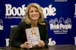 "Texas Democratic gubernatorial candidate Sen. Wendy Davis shows her book ""Forgetting to be Afraid"" at Book People on September 11th, 2014"