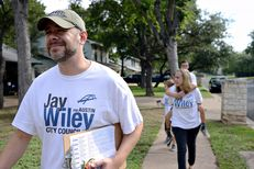 Jay Wiley, a candidate for Austin City Council, block walked on Saturday with campaign team member Corey Rose, back, and Wiley's family: wife, Sally, and sons Anders, 7, and Dyson, 8.