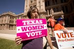 A day after a federal appeals court allowed Texas to begin enforcing new abortion restrictions, a group protested the ruling on the South Steps of the Texas Capitol building.