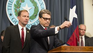 Texas Sen. Dr. Charles Schwertner, R-Georgetown, and Texas Gov. Rick Perry at a Capitol press conference on Monday announcing creation of a Texas infectious disease task force.