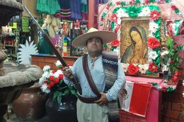 Historian Antonio Ramos poses as a Maderista soldier at a marketplace in Ciudad Juárez, Mexico, on Oct. 8, 2014.