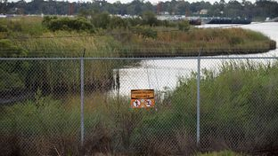 The San Jacinto River Waste Pits, an EPA Superfund site that is contaminated with dioxins, is located on Interstate 10 east of Houston.