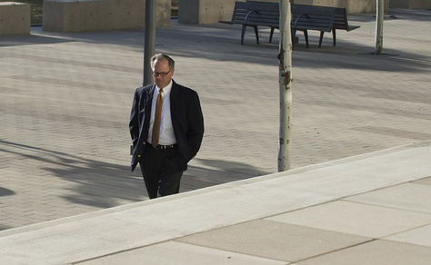 Former Dewhurst consultant Buddy Barfield walks to Austin federal court to plead guilty of embezzling almost $2-million in campaign funds on Oct. 21, 2014.