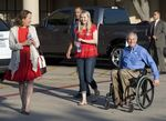 GOP gubernatorial candidate Greg Abbott, with wife Cecilia and daughter Audrey, leaves a south Austin polling place after voting early.
