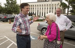 Sen. Dan Patrick greets a supporter at St. Martin's Church in Houston, Texas on the morning of November 4th, 2014