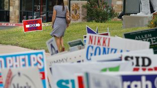 Voters enter and a polling station at the Ben Hur Shrine Temple in northwest Austin Tuesday, Nov. 4, 2014.