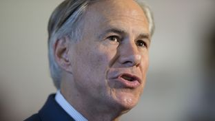 Greg Abbott talks to reporters at the Texas Capitol on Nov. 5, 2014, the day after he was elected governor.