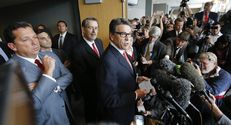 Gov. Rick Perry addresses the media following his court hearing on Nov. 6, 2014.  At far left is attorney Tony Buzbee.