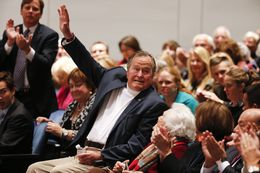 George H.W. Bush waves as he is introduced at Texas A&M University on Nov. 11, 2014.
