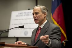 Attorney General Greg Abbott indicates his willingness to sue President Obama on immigration during a press conference Nov. 24, 2014.