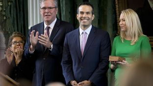 George P. Bush is all smiles as his mother, Columba, father, Jeb, and wife, Amanda, applaud during Bush's swearing in as Texas Land Commissioner on Jan. 2, 2015.