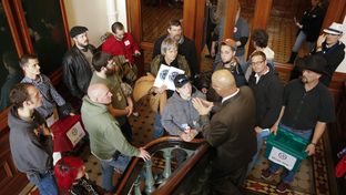 Senate Sergeant at Arms Rick DeLeon tells a group from Lone Star Gun Rights that they are not allowed in the secure back hall of the Senate on opening day Jan. 13, 2015.