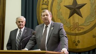 State Rep. John Otto, r,  proposes a constitutional amendment to use Rainy Day fund money to pay off state debt during a short press conference Jan. 15, 2015. At left is State Rep. Jimmy Don Aycock.