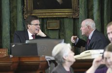 Lt. Gov. Dan Patrick has a chat with Sen. Kel Seliger, R-Amarillo, after calling a recess in the Senate on Jan. 21, 2015.