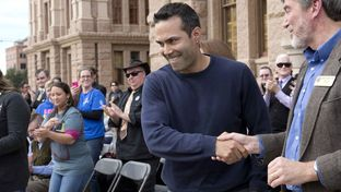 Land Commissioner George P. Bush shakes hands with Texas Alliance for Life Director Joseph Pojman at the Texas Capitol on Jan. 24, 2015