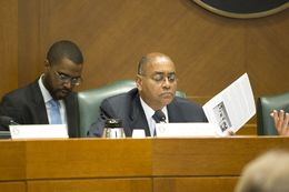 Sen. Rodney Ellis D-Houston reads information during the Senate Committee on State Affairs as they listen to testimony relating to guns on campus and open carry on February 12th, 2015