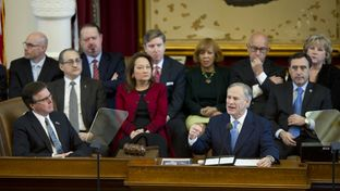 Legislators listen as Gov. Greg Abbott delivers his State of the State speech on Feb. 17, 2015.
