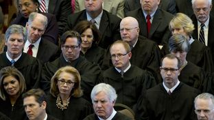 Texas Supreme Court and Court of Criminal Appeals justices listen to Chief Justice Nathan Hecht's State of the Judiciary speech to legislators on Feb. 18, 2015.