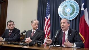 Attorney General Ken Paxton, r, with U.S. Sen. Ted Cruz and Gov. Greg Abbott during the press conference praising federal Judge Andrew S. Hanen's immigration ruling on Feb. 18, 2015.