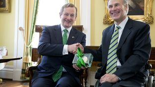 Irish Prime Minister Enda Kenny receives a Texas belt buckle from Gov. Greg Abbott at the Governor's Mansion on March 15, 2015.