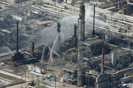 Firefighters pour water on a smoldering unit following an explosion that rocked the BP refinery Wednesday, March 23, 2005, in Texas City, Texas. The explosion reportedly killed four, and injured 60 people.