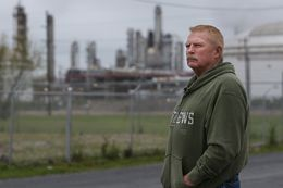 Dave Leining, who was badly injured in the 2005 BP refinery explosion, stands outside of the refinery which is currently owned by Marathon Petroleum on Tuesday, March 10, 2015, in Texas City.  The trailer where Leining was working flew apart, burying him and co-workers in rubble.