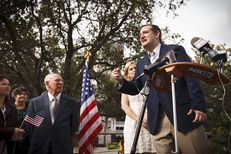 U.S. Sen. Ted Cruz speaks to supporters with his father Rafael, left, and wife Heidi, back, outside his new presidential campaign headquarters in Houston on Tuesday, March 31, 2015.