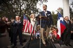U.S. Sen. Ted Cruz speaks to supporters with his father Rafael, his wife Heidi and their children outside his new presidential campaign headquarters in Houston on March 31, 2015.