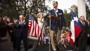U.S. Sen. Ted Cruz speaks to supporters with his father Rafael, his wife Heidi and their children outside his new presidential campaign headquarters in Houston on Tues. March 31, 2015.