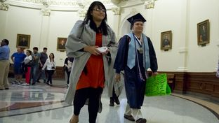 Students arrive in caps & gowns to Texas Capitol on April 6th, 2015. The Senate sub-committee on border security will listen to testimony on SB #1819 relating to determination of resident status of students by public institutions of higher education