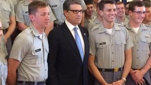 Former Gov. Rick Perry poses with cadets after delivering a foreign policy speech Monday at The Citadel, South Carolina's military college. The likely 2016 presidential candidate blasted President Barack Obama's foreign policy and offered his own plan to reassert American influence abroad.